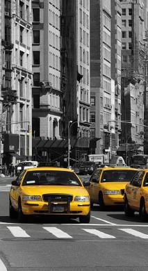 Fototapeta z żółtą taksówką